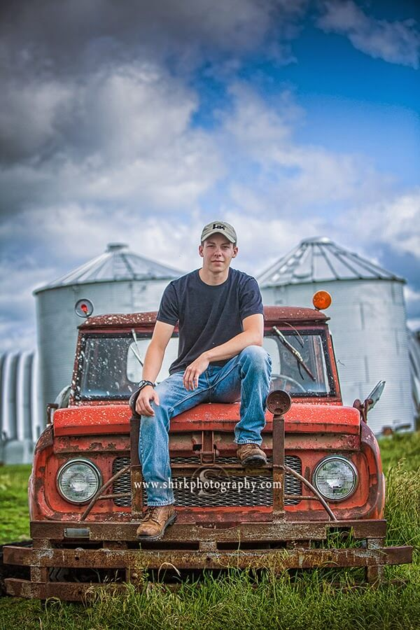 senior guy old red truck country