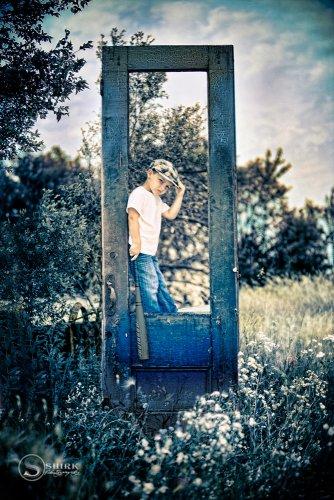 Shirk-Photography-Family-Portraits-Iowa-Creative-Boy-Child-Door-Outdoors-Baseball