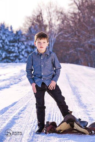 Shirk-Photography-Family-Portraits-Iowa-Creative-Boy-Child-Winter-Snow-Saddle